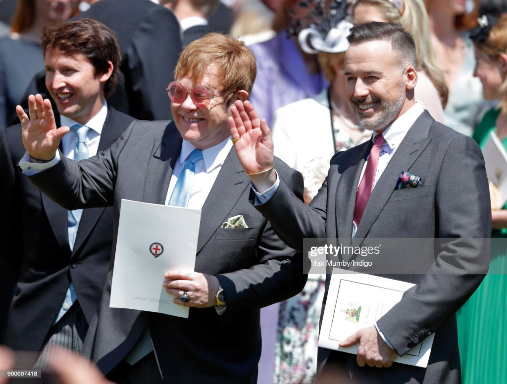 Elton John and David Furnish attend the wedding of Prince Harry to Ms Meghan Markle at St George's Chapel, Windsor Castle on May 19, 2018 in Windsor, England. Prince Henry Charles Albert David of Wales marries Ms. Meghan Markle in a service at St George's Chapel inside the grounds of Windsor Castle. Among the guests were 2200 members of the public, the royal family and Ms. Markle's Mother Doria Ragland.