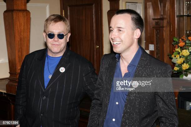 Elton John and David Furnish celebrate the 1st Anniversary of Billy Elliot the Musical backstage at Victoria Palace Theatre on May 12 2006 in London...
