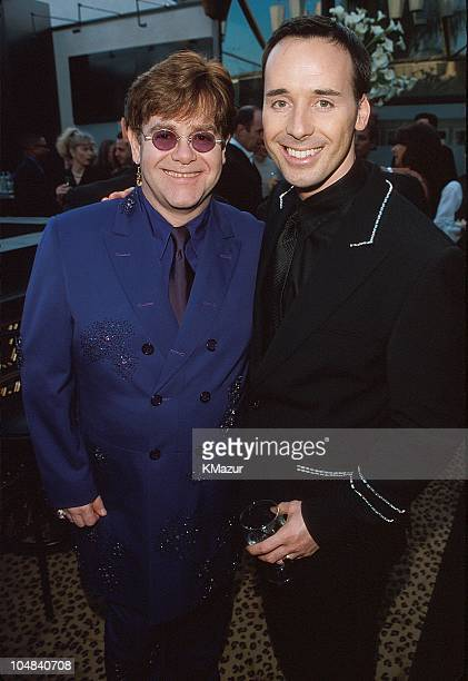 Elton John and David Furnish during The 71st Annual Academy Awards Elton John AIDS Foundation Party at Pagani's in Los Angeles California United...