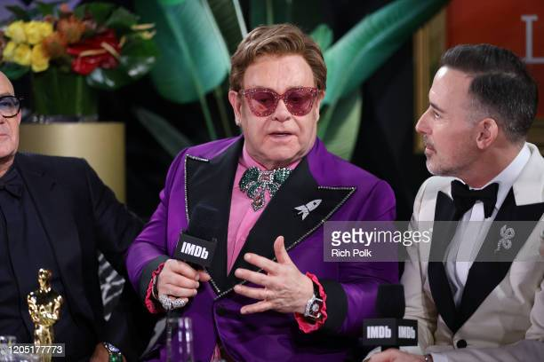 Elton John and David Furnish speak onstage at IMDb LIVE Presented By M&M'S At The Elton John AIDS Foundation Academy Awards Viewing Party on February...