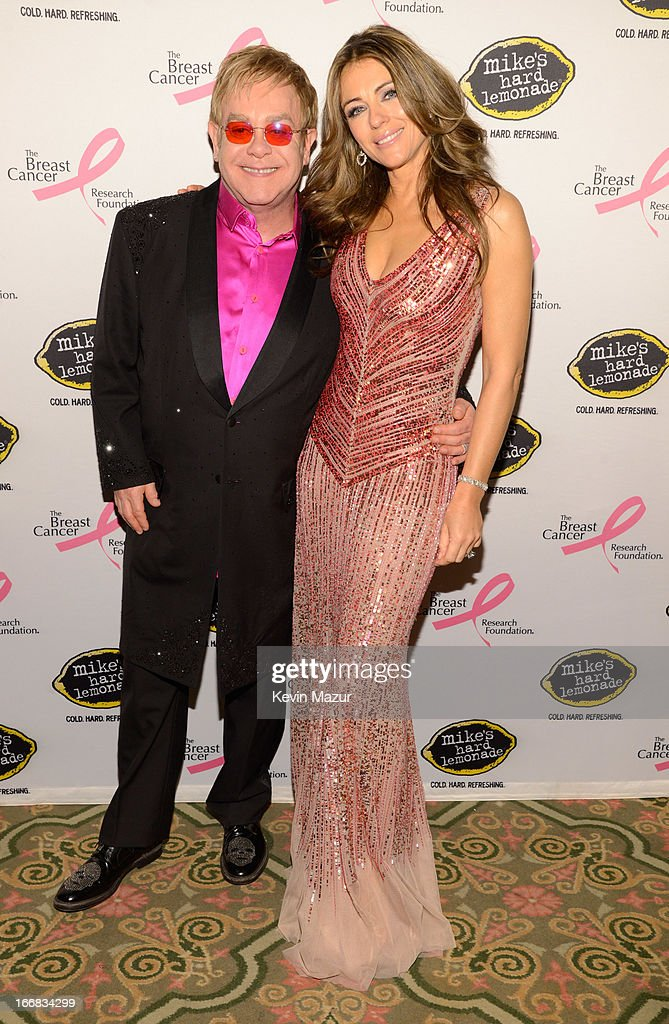 Elton John and Elizabeth Hurley attend the Breast Cancer Foundation's Hot Pink Party at the Waldorf Astoria Hotel on April 17, 2013 in New York City.