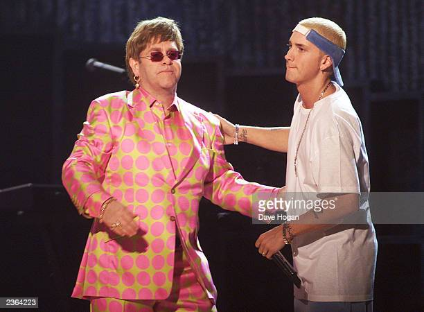 Elton John and Eminem end their duet performance at the 43rd Annual Grammy Awards at Staples Center in Los Angeles CA on February 21 2001 Photo...