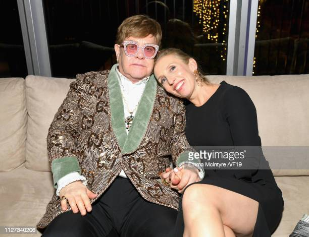 Elton John and guest attend the 2019 Vanity Fair Oscar Party hosted by Radhika Jones at Wallis Annenberg Center for the Performing Arts on February...