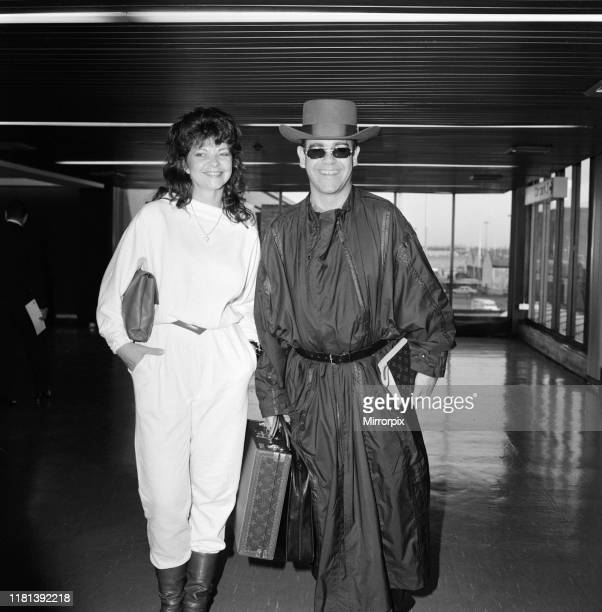 Elton John and his new wife Renate arriving at Heathrow Airport from hong Kong 2nd April 1984