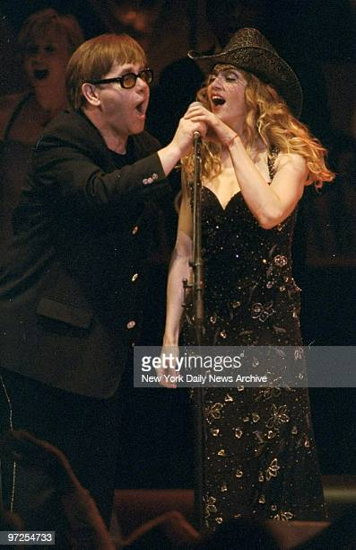 Elton John and Madonna do a duet at finale of the Rain Forest Concert at Carnegie Hall