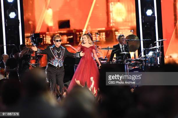 Elton John and Miley Cyrus at THE 60TH ANNUAL GRAMMY AWARDS broadcast live on both coasts from New York Citys Madison Square Garden on Sunday Jan 28...