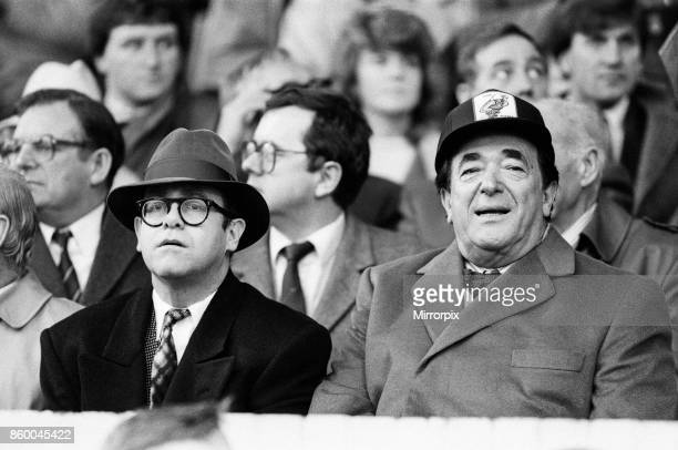 Elton John and Robert Maxwell watching the Oxford United v Watford football match. Final score 1-1. League Division One. Elton John had announced...