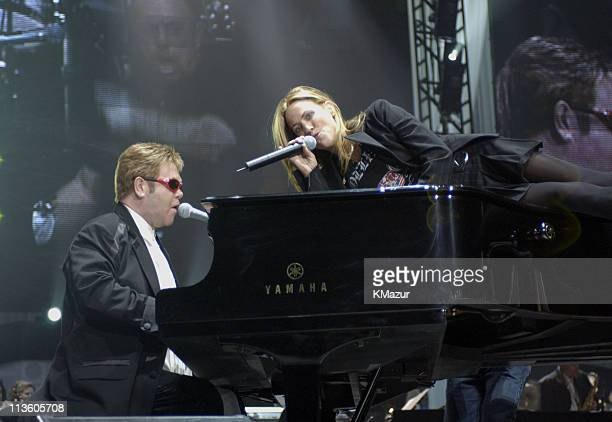 Elton John and Sheryl Crow during The Andre Agassi Charitable Foundation's 8th 'Grand Slam for Children' Fundraiser Show at The MGM Grand Hotel and...
