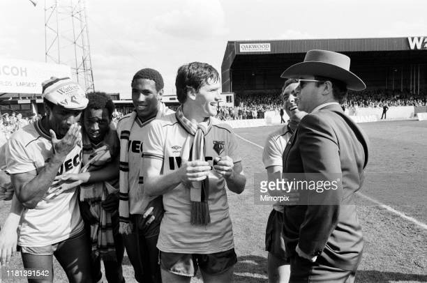 Elton John and some of the Watford side after their match against Liverpool 14th May 1983
