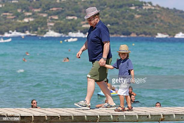 Elton John and their son Zachary Jackson Levon Furnish-John arrive at 'club55' for lunch on August 21, 2015 in Saint-Tropez, France.