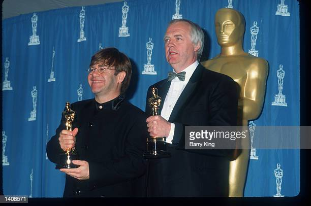 Elton John and Tim Rice attend the 67th Annual Academy Awards ceremony March 27 1995 in Los Angeles CA This year''s ceremony recognizes excellence in...