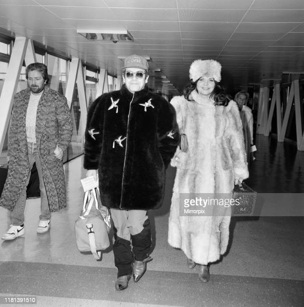 Elton John and wife Renate leaving Heathrow Airport for Washington where he is to play tennis 11th February 1986