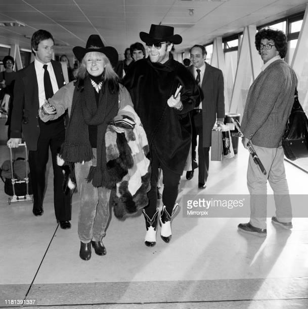Elton John and Zandra Rhodes at Heathrow. 11th January 1981.