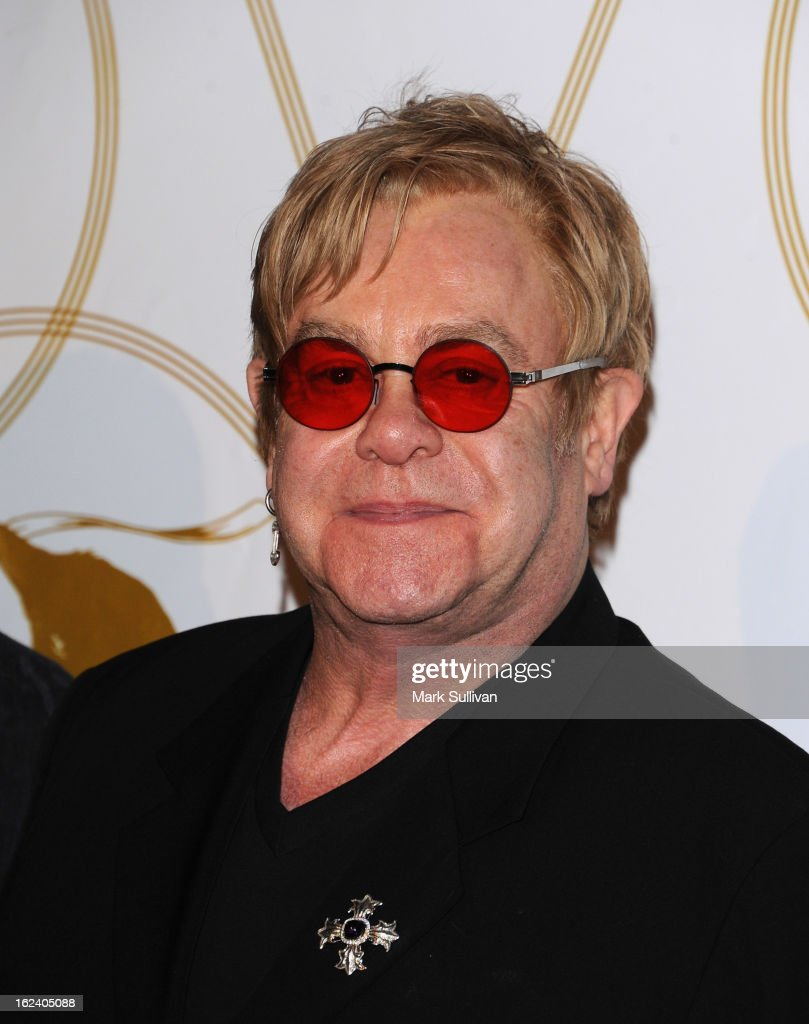 Elton John arrives at the LOVEGOLD cocktail party to celebrate 'How To Survive A Plague' at Chateau Marmont on February 22, 2013 in Los Angeles, California.