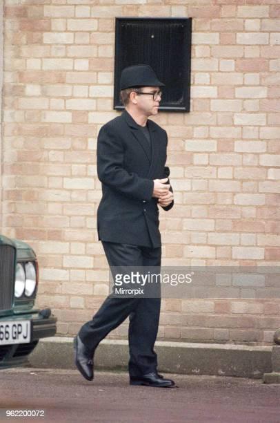 Elton John at Brian May at Freddie Mercury's funeral at West London Crematorium 27th November 1991