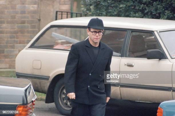 Elton John, at Freddie Mercury's funeral at West London Crematorium, 27th November 1991.