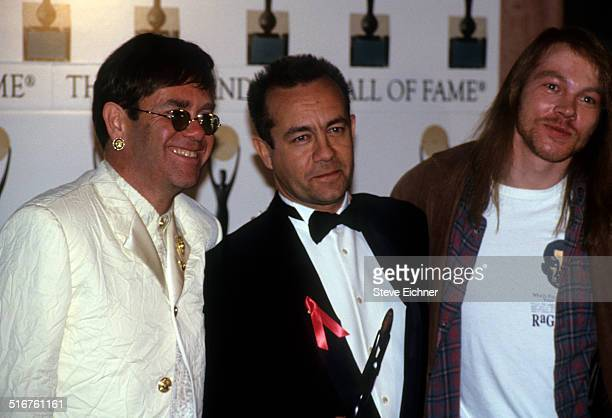 Elton John Axl Rose of Guns N' Roses and Bernie Taupin at Rock and Roll Hall of Fame Waldorf Astoria New York January 19 1994