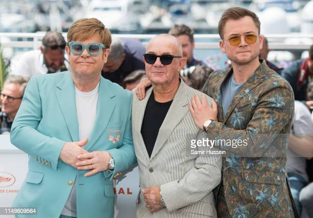 Elton John Bernie Taupin and Taron Egerton attend the photocall for Rocketman during the 72nd annual Cannes Film Festival on May 16 2019 in Cannes...