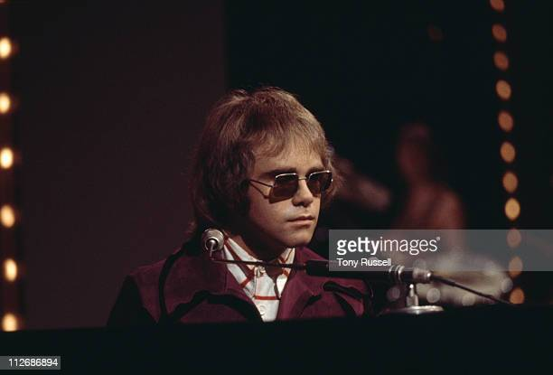 Elton John British singersongwriter performing on the BBC television show Top of the Pops London England Great Brtitain April 1974