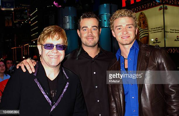 Elton John Carson Daly and Justin Timberlake during Elton John and Justin Timberlake Visit MTV's TRL January 11 2002 at MTV's Time Square Studios in...