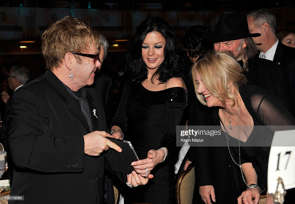elton john catherine zeta jones neil young and pegi young attend a news photo getty images. Black Bedroom Furniture Sets. Home Design Ideas
