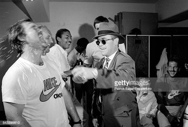 Elton John celebrates with England captain Mike Gatting and the England players in the dressing room after England won the 4th Test match between...