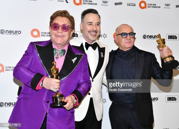 Elton John, David Furnish, and Bernie Taupin attend the 28th Annual Elton John AIDS Foundation Academy Awards Viewing Party Sponsored By IMDb And...