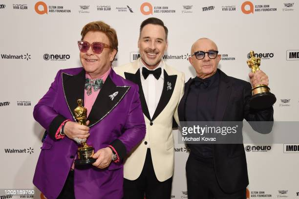 Elton John, David Furnish and Bernie Taupin attend the 28th Annual Elton John AIDS Foundation Academy Awards Viewing Party sponsored by IMDb, Neuro...