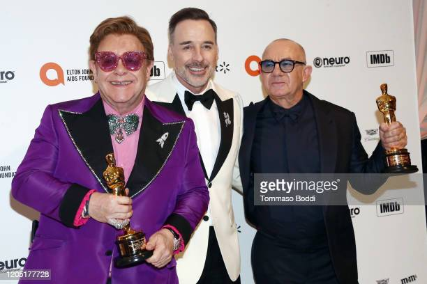Elton John David Furnish and Bernie Taupin walk the red carpet at the Elton John AIDS Foundation Academy Awards Viewing Party on February 09 2020 in...