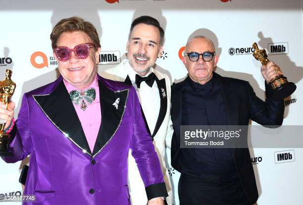 Elton John, David Furnish and Bernie Taupin walk the red carpet at the Elton John AIDS Foundation Academy Awards Viewing Party on February 09, 2020...