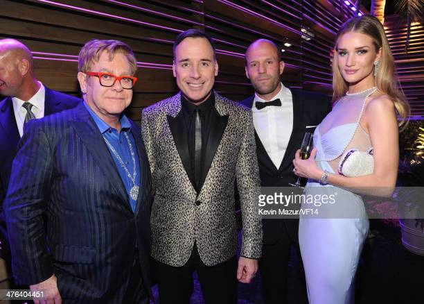Elton John David Furnish Jason Statham and Rosie HuntingtonWhitley attend the 2014 Vanity Fair Oscar Party Hosted By Graydon Carter on March 2 2014...