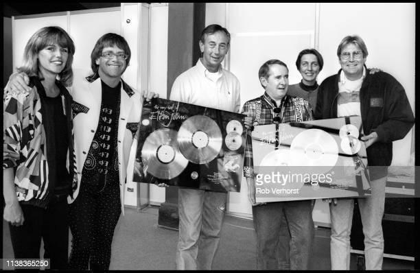 Elton John gets award in Holland from Jan Corduwener , Feyenoord Stadium 'de Kuip', Rotterdam, 19th June 1992.