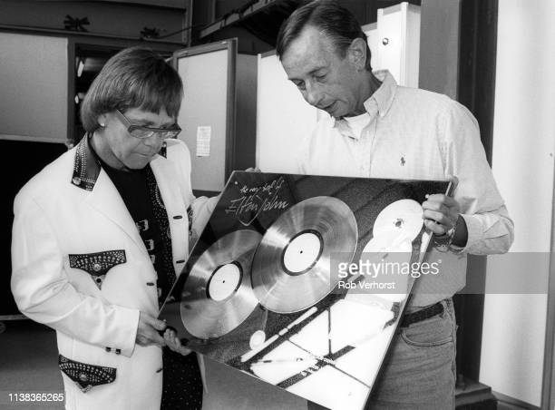 Elton John gets award in Holland from Jan Corduwener Feyenoord Stadium 'de Kuip' Rotterdam 19th June 1992