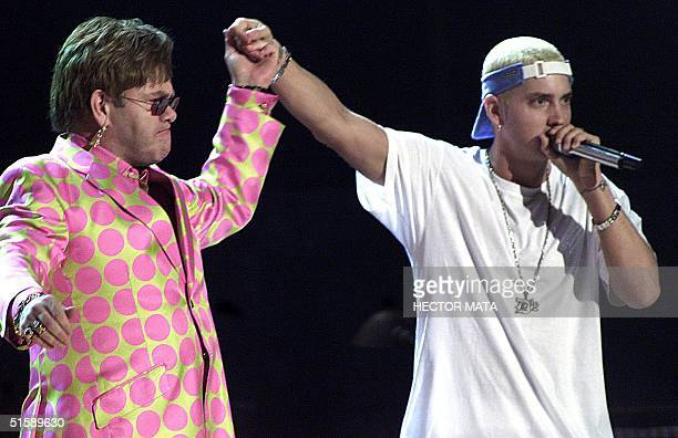 Elton John joins rap musician Eminem during their much anticipated performance at the 43rd Annual Grammy Awards 21 February 2001 at the Staples...