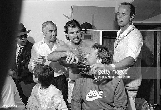 Elton John Laurie Brown and Liam Botham celebrate with England players Allan Lamb Ian Botham and Phil Edmonds in the dressing room after England won...
