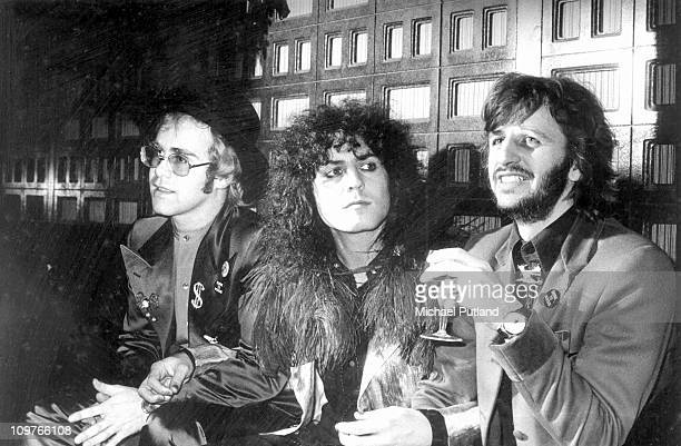 Elton John, Marc Bolan of T-Rex and Ringo Starr of The Beatles having a drink together to promote the film 'Born To Boogie' in 1972.