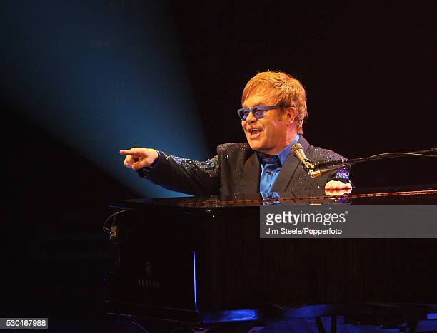 Elton John performing on stage during the Peace One Day concert at Wembley Arena in London on the 21st September 2012