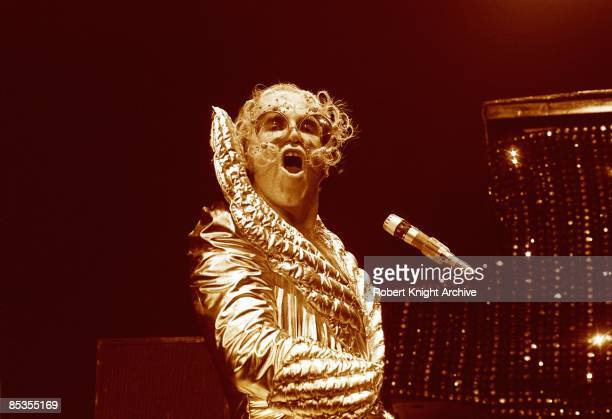 Elton John performing on stage in a shiny costume at Hawaii International Center Honolulu Hawaii United States October 1974