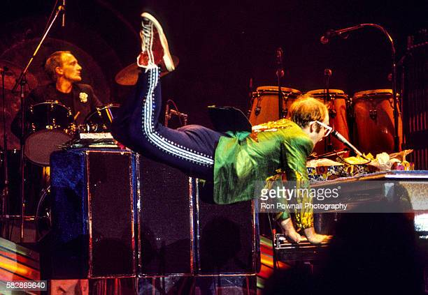 Elton John performs at Madison Square Garden New York City August 1976 Ray Cooper on drums