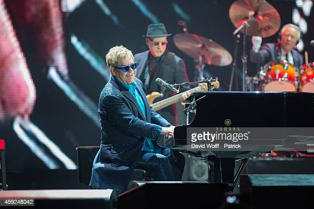 Elton John performs at Palais Omnisports de Bercy on November 19, 2014 in Paris, France.