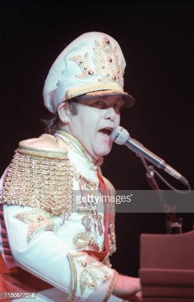 Elton John performs on stage at Hammersmith Odeon, on December 9th, 1982 in London, England.