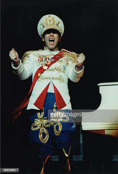 Elton John performs on stage at Hammersmith Odeon on December 9th, 1982 in London, England.