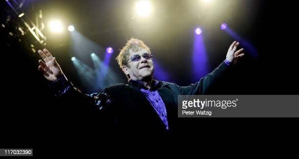 Elton John performs on stage at the LanxessArena on June 19 2011 in Cologne Germany