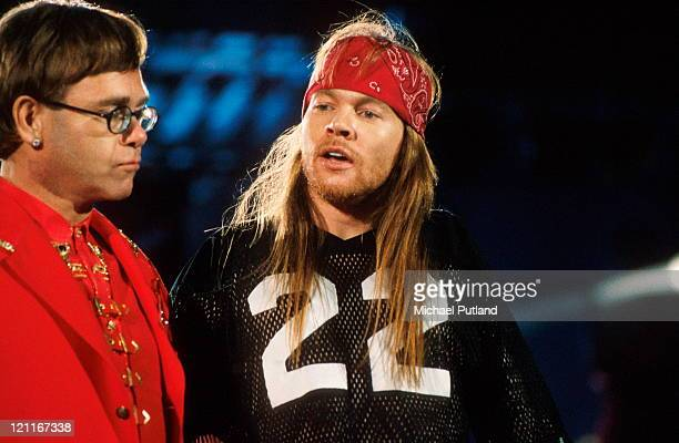 Elton John performs on stage with Axl Rose of Guns 'n' Roses at Freddie Mercury Tribute Concert, Wembley Stadium, London, 20th April 1992.