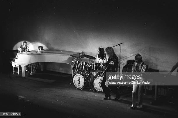 Elton John performs on stage with Nigel Olsson, Davey Johnstone and Dee Murray at the 1972 Royal Variety Performance at the London Palladium, 30th...
