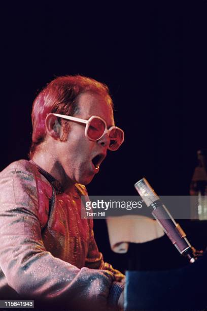 Elton John performs with his band at the University of Georgia's Stegeman Coliseum on October 25, 1973 in Athens, Georgia, United States.
