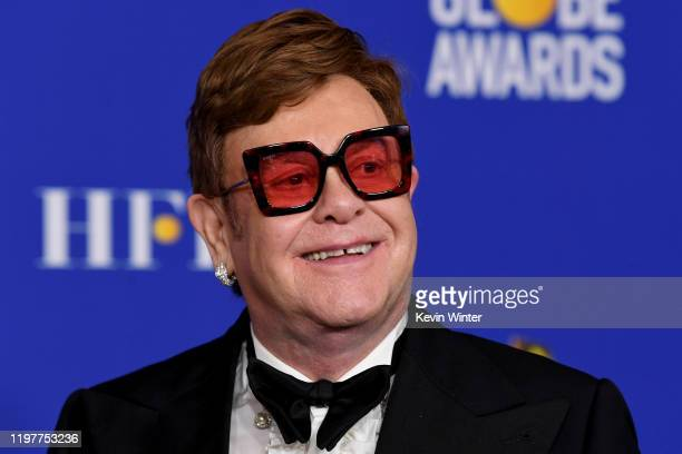 Elton John poses in the press room with the award for Best Original Song Motion Picture during the 77th Annual Golden Globe Awards at The Beverly...