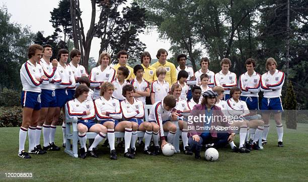 Elton John poses with the England Football Team and some young prize winners circa 1979 The England players are Phil Neal Trevor Brooking Dave Watson...