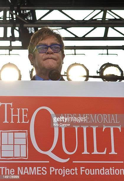 Elton John speaks during a photoop at the AIDS Memorial Quilt on the National Mall on July 23 2012 in Washington DC
