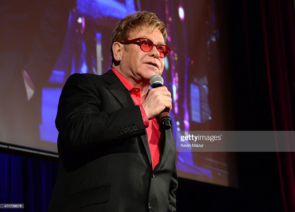 Elton John speaks onstage during Breast Cancer Research Foundation's Hot Pink Party: The Pink Standard at Waldorf Astoria Hotel on April 30, 2015 in New York City.